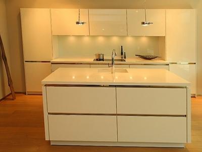 Современная линейная   кухня с островом в квартиру студию